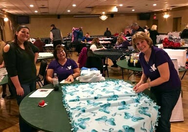 Volunteers Making Blankets Thumbnail